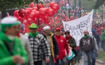 Union members march with banners and balloons during a demonstration regarding labor reforms in Brussels on Tuesday, May 24, 2016. (AP Photo/Virginia Mayo)