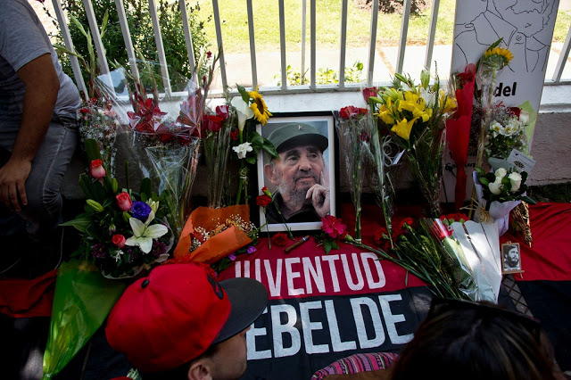 Flowers, banners and a picture of Fidel outside the Cuban Embassy in Santiago de Chile.